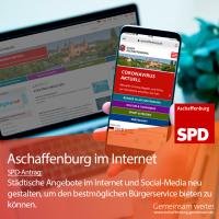 Homepage der Stadt auf Laptop und Handy